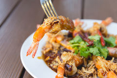 Fork stabbing Fried Shrimp with Tamarind Sauce Royalty Free Stock Photography