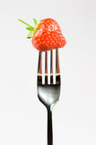 Fork and strawberry Stock Photography