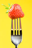 Fork and strawberry Royalty Free Stock Photo