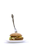 Fork stuck in a fat sandwich Stock Photos