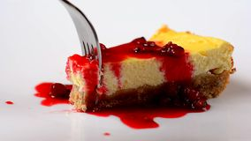 Fork in sweet cheesecake with red fruits stock video footage