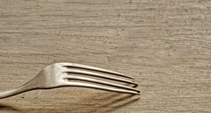 Fork on table Royalty Free Stock Photos