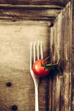 Fork and tomato Stock Photo