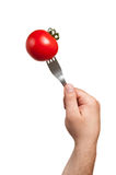 The fork in the tomato Stock Photo
