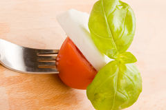 Fork with tomatoe and mozzarella Royalty Free Stock Images