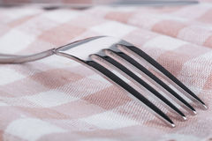 Fork on towel Stock Photography