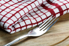 Fork and towel closeup Stock Photos