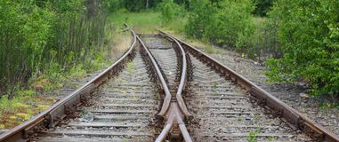 The old railway. The fork in the train tracks royalty free stock photography