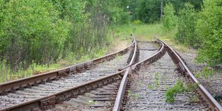 The old railway. The fork in the train tracks royalty free stock photo