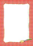 Fork Twirling Spaghetti Frame. Bright border of a fork twirling a spaghetti noodle with a red gingham background Royalty Free Stock Images