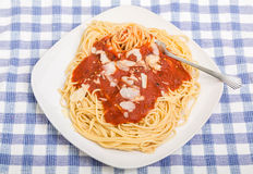 Fork Twirling Spaghetti with Tomato Sauce and Parmesan Stock Images