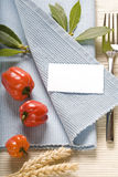 Fork and vegetabels on blue napkin Stock Photo
