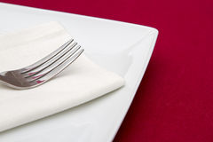 Fork on white napkin and plate Royalty Free Stock Image