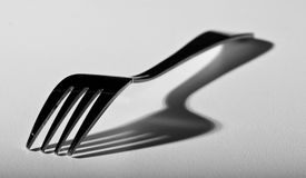 Fork on white surface Royalty Free Stock Photos