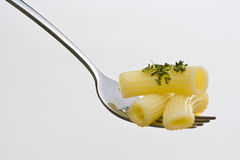 Fork wiht fresh pasta and sauce oregano Stock Photo