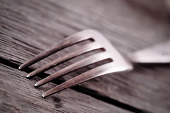 Fork on the wood background Stock Images