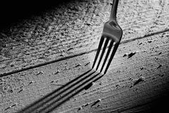 Fork on wood table Royalty Free Stock Image