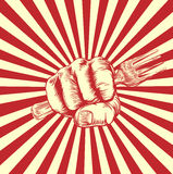 Fork Woodcut Propaganda Fist Hand. A hand in a fist holding a spanner or wrench in a vintage propaganda poster woodcut style Stock Photo