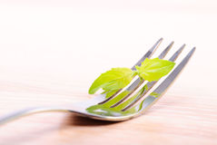 Fork on wooden table Stock Photo