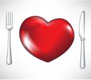 Fork y cuchillo con el corazón rojo Imágenes de archivo libres de regalías