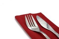 Fork y cuchillo en servilleta roja Fotografía de archivo libre de regalías