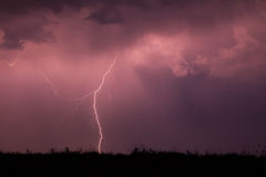 Forked Lightning against a pitch black sky Stock Photos