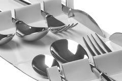 Forkes, cucharas y cuchillos del acero inoxidable Imágenes de archivo libres de regalías