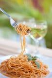 Forkful of spaghetti with tomato sauce stock photo