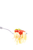 Forkful with succulent and tasty spaghetti with tomato sauce Stock Photos