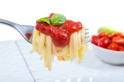 Forkful with succulent and tasty spaghetti with tomato sauce Stock Photo
