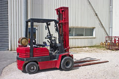 Forklift. Well used red forklift Royalty Free Stock Image