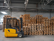 Forklift. Ready for work in a real warehouse royalty free stock image