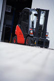 Forklift. The red forklift in a logistic warehouse with Stock Image
