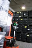 Forklift. The red forklift in a logistic warehouse with Stock Photo