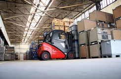 Forklift. In a big warehouse with palettes Royalty Free Stock Photo