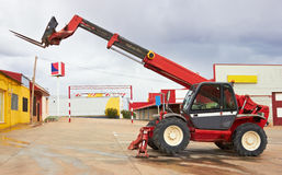 Forklift. Construction equipment, red forklift against sky stock photo