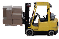 Forklift. Industrial forklift with a load of warehouse boxes Royalty Free Stock Photography
