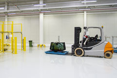 Forklift, bright spacious warehouse. On industria wall Stock Photography