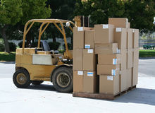 Forklift Carrying Boxes. A photo of a forklift carrying boxes Royalty Free Stock Images