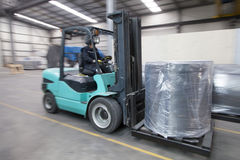 Forklift carrying cargo Royalty Free Stock Photos