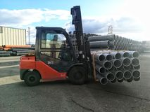 Forklift carrying plastic drain pipes pvc stock images