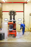 Forklift Cleaning Royalty Free Stock Photography