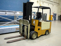 Forklift closeup. Closeup of a forklift on a factory workplace floor Royalty Free Stock Photography