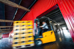 Forklift coming out a warehouse. Stock Photo