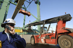 Forklift, crane and container port Stock Images