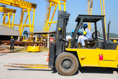 Forklift in crane work Royalty Free Stock Image