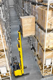 Forklift in a distribution warehouse Royalty Free Stock Photography