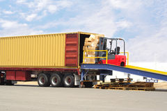 Forklift and dock royalty free stock photography