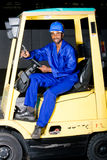 Forklift driver. African american male forklift driver Stock Images