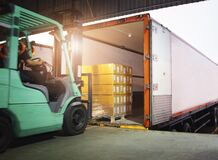 Free Forklift Driver Loading Package Boxes Into Cargo Container. Cargo Trailer Truck Parked Loading At Dock Warehouse. Royalty Free Stock Photos - 213932718